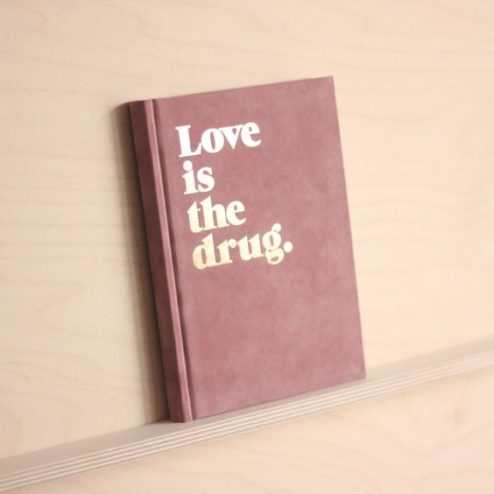 Notizbuch love is the drug pink
