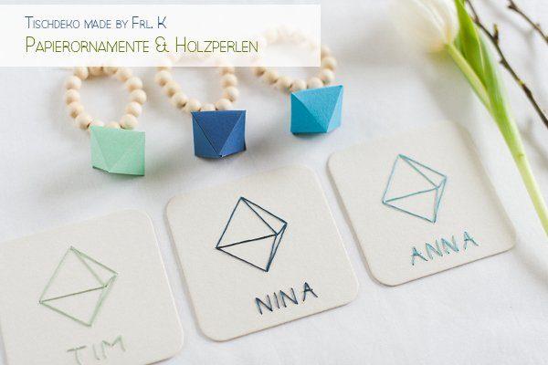 Tischdeko grafisch mit Papierornamenten und Holzperlen