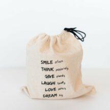 Kerze mit Geschenkbeutel 'SMILE, THINK, GIVE, LAUGH, LOVE, DREAM'