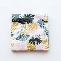 Papierserviette mit bunten Palmenblättern